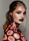 Fashion model with art make up orange and black color Royalty Free Stock Images