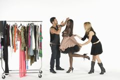 Fashion Model With Artists Adjusting Her Outfit Stock Photography