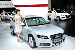 Fashion Model on Audi A4L saloon car Royalty Free Stock Image