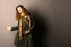Fashion model in autumn/winter clothes. High contrast photo Stock Photos