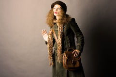 Fashion model in autumn/winter clothes Royalty Free Stock Photo