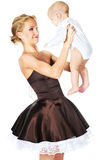 Fashion model with a baby. Fashion model looking at baby with suprrise stock images