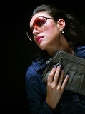 Fashion model with a bag Royalty Free Stock Image