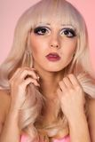 Fashion model with  barbie doll make-up Stock Images