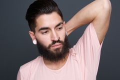 Fashion model with beard and piercing Royalty Free Stock Image