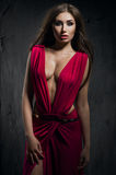 Fashion model in beautiful red dress Stock Photography