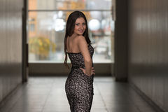 Fashion Model From Behind In Beautiful Black Dress Royalty Free Stock Images