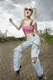 Fashion model behind net webbing stock images