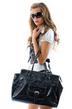 Fashion model with big bag. Isolated over white background Royalty Free Stock Photo