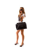 Fashion model with big bag. Isolated on white background Royalty Free Stock Photo