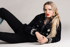 Fashion model in black clothing. And luxury accessories royalty free stock photography