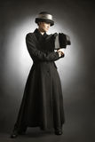 Fashion model in black coat. And hat. Woman in autumn clothes Royalty Free Stock Photo