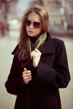 Fashion model in black coat Royalty Free Stock Photos