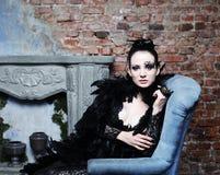 Fashion model in black dress Royalty Free Stock Photo