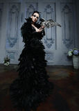 Fashion model in black dress Royalty Free Stock Image