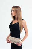Fashion model in black dress and handbag Royalty Free Stock Photos