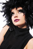 Fashion model with black feathers as hair. Stock Photo