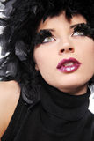 Fashion model with black feathers as hair. Royalty Free Stock Photo