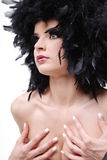 Fashion model with black feathers as hair. Royalty Free Stock Photography