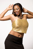 Fashion model in black and gold dress. Stock Photos