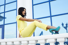 Fashion model with black hair in elegant yellow suit Stock Image