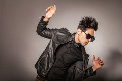 Fashion model with black jacket posing. Stock Photo