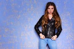 Fashion model black leather jacket. Punk, rock style fashion. Fashion model black leather jacket. Pixie cut hairstyle. Punk, rock style fashion Royalty Free Stock Images