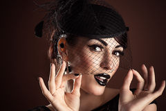 Fashion model with black makeup Royalty Free Stock Photos