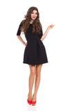 Fashion Model in Black Mini Dress Pointing Stock Image