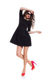Fashion Model in Black Mini Dress and Red High Heels Stock Photography
