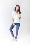 Fashion model in a blouse and jeans barefoot Stock Photo