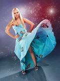 Fashion model in a blue dress Stock Image