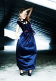 Fashion model in blue dress - urban scene Royalty Free Stock Photo