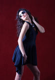 Fashion model in a blue dress wearing sunglasses Stock Photos