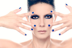 Fashion model with blue nail polish Stock Images