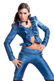 Fashion Model in Blue Satin. Dramatic pose of a young woman dressed in a ruffled blue satin blouse and pants Stock Photo