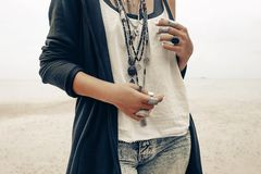 Close up of boho style woman with stylish accessories and jewell. Fashion model with boho accessories outdoors close up Royalty Free Stock Photo