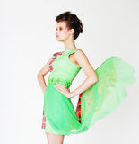 Fashion model in bright green dress Royalty Free Stock Image
