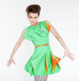 Fashion model in bright green dress Stock Images