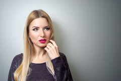 Fashion model with bright make-up. Portrait of young fashion woman with long blond hair Royalty Free Stock Photos