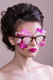 Fashion model with bright makeup and colorful glitter and sparkles on her face and body. Royalty Free Stock Photos