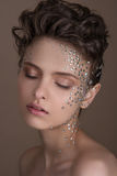 Fashion model with bright makeup and colorful glitter and sparkles on her face and body. Fashion model with bright makeup and colorful glitter and sparkles on royalty free stock images