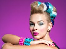 Fashion model with bright makeup and creative hairstyle royalty free stock images