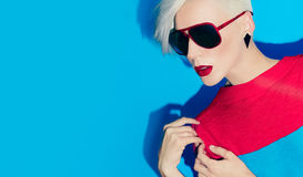 Fashion model with bright makeup and multi-coloured hair. Art ph Stock Photography