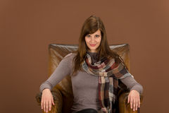 Fashion model on brown leather armchair Royalty Free Stock Photos