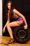 Fashion model on car wheel Stock Image