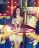 Fashion model on carousel Royalty Free Stock Photos