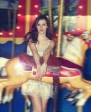 Fashion model on carousel Royalty Free Stock Photos