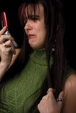 Fashion model - cell. Twenty something fashion model upset over call on cell phone Stock Photo