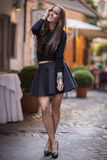Fashion model with city lights in background. rome, Italy Royalty Free Stock Photography
